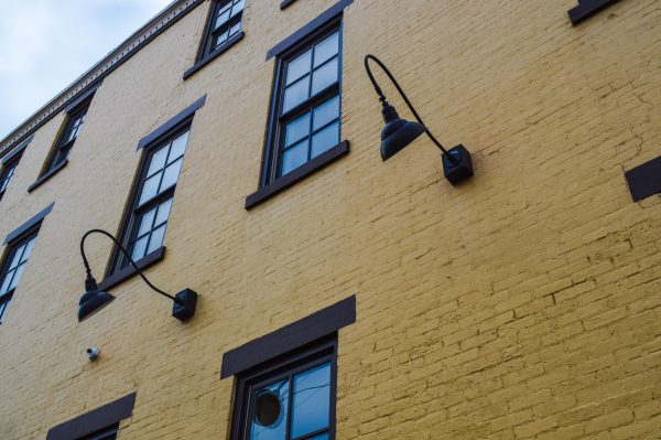 They may appear as simple lamps, but Childers believes illuminating the corner of 22nd Street and Lane B adds warmth to the historic district.