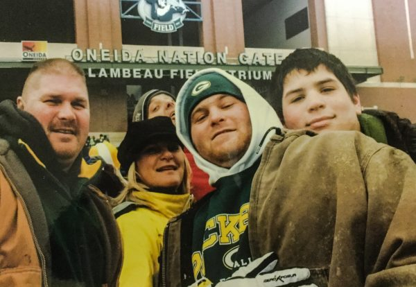 Lesley (in the middle wearing the gold jacket) traveled to Green Bay with family members to celebrate her son's 21st birthday by attending a Packers game.