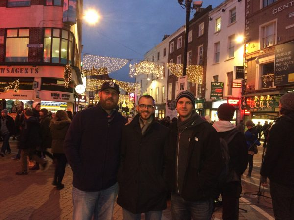 Brian Jones, Derrick McKee, and Josh McKee at the entrance to the Grafton Street Promenade in Dublin, Ireland.