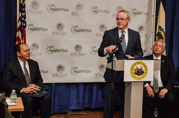 Jim Pennington, CEO of The Health Plan, is flanked by West Virginia Gov. Earl Ray Tomblin (on left) and Senate President Bill Cole.