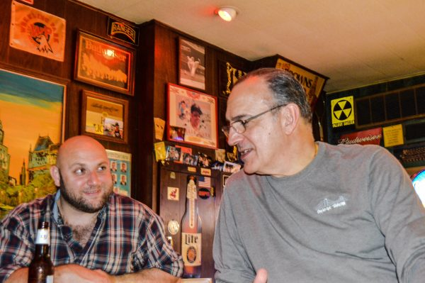 George Dormas, on right, owns the Bridge Tavern in downtown Wheeling.