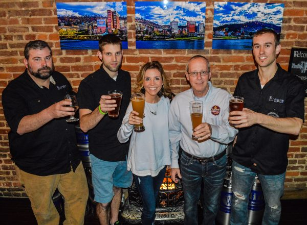 Jim Chaney, Jimmy Schulte, Erin Ball, Carl Carenbauer, and Brian Main taste a few of the brews that will be distributed in Ohio and Marshall counties.