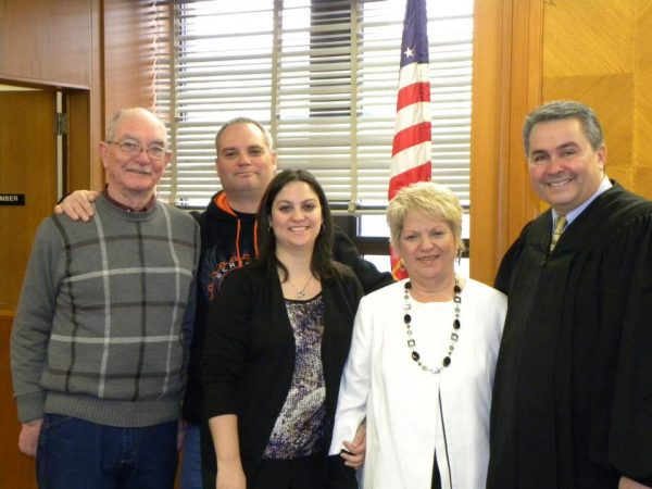 The Hoffmans (Tom Sr., Tom Jr., Tiffany, and Kathie) with Ohio County Circuit Court Judge James Mazzone.