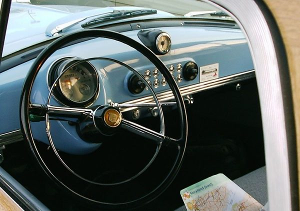 Inside of a Nash like the family car George left behind and Mabel had to conquer.