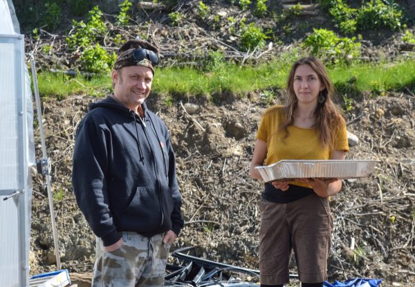 Ken Peralta and Joselyn Carlson pause from the their work at the new greenhouse facilities.