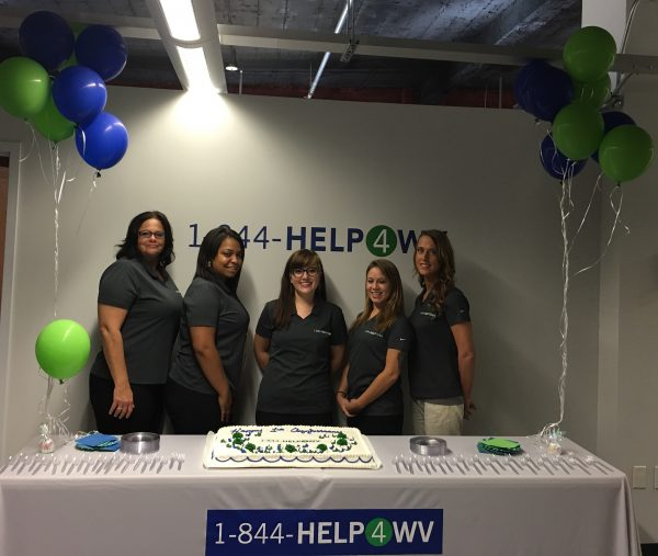 Helpline Agents Chrissy McAtee , LeAnne Wilkerson with assistant program director Andrea St. Clair; Helpline Agent Jaimee Moffitt, and Program Director Heather McDaniel.
