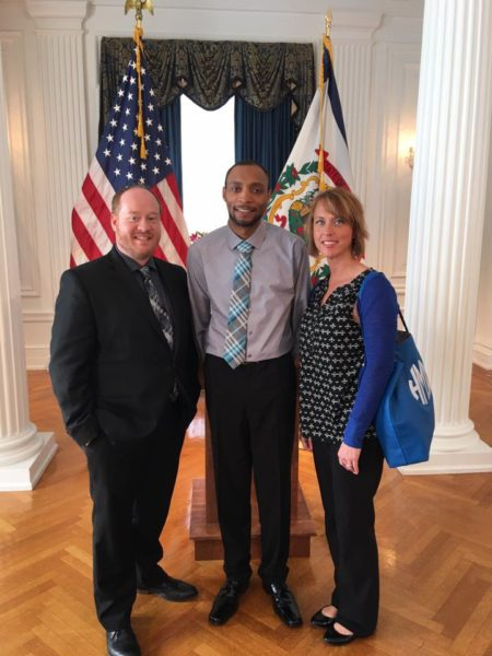 Outreach coordinator Jeremy Smith and Program Director Heather McDaniel accompany HELP4WV caller Jermaine (center) as he talks publicly about his struggle with addiction.