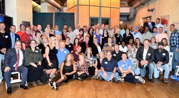 Christie, sitting near the middle of the photo, traveled to Wheeling last weekend for the 30-year reunion of Wheeling Park High's 30th reunion. (Photo by Steve Novotney)