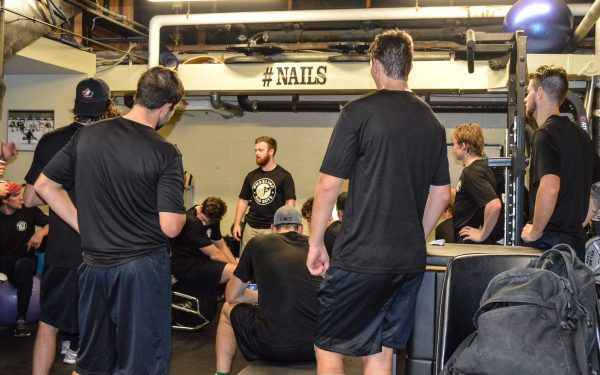 Athletic trainer Seamus McKelvey instructs the Nailers during training camp at Wesbanco Arena.