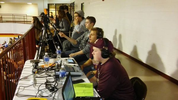 Isaac Basinger, Alex Calvert, Chris Costain and Brayden Carter call a Maroon Knights basketball game.