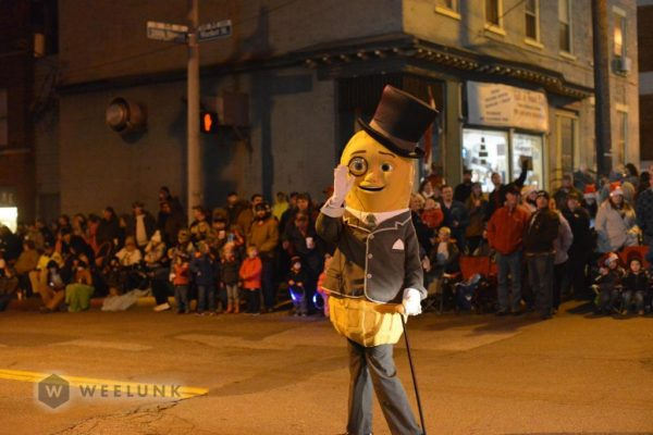 """Mr. Peanut"" from Planters waved to all the children and adults one year ago."