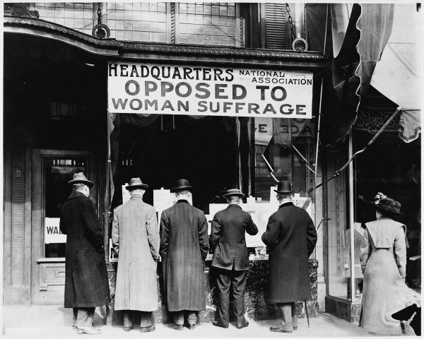 Men stand at the Headquarters Opposed to Woman SUffrage