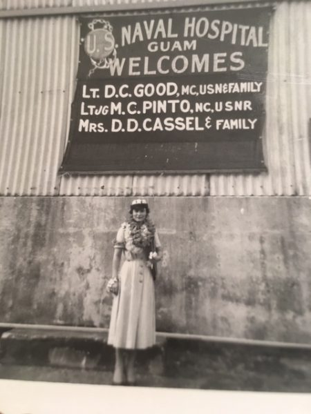 Marie standing under a welcome sign in Guam.