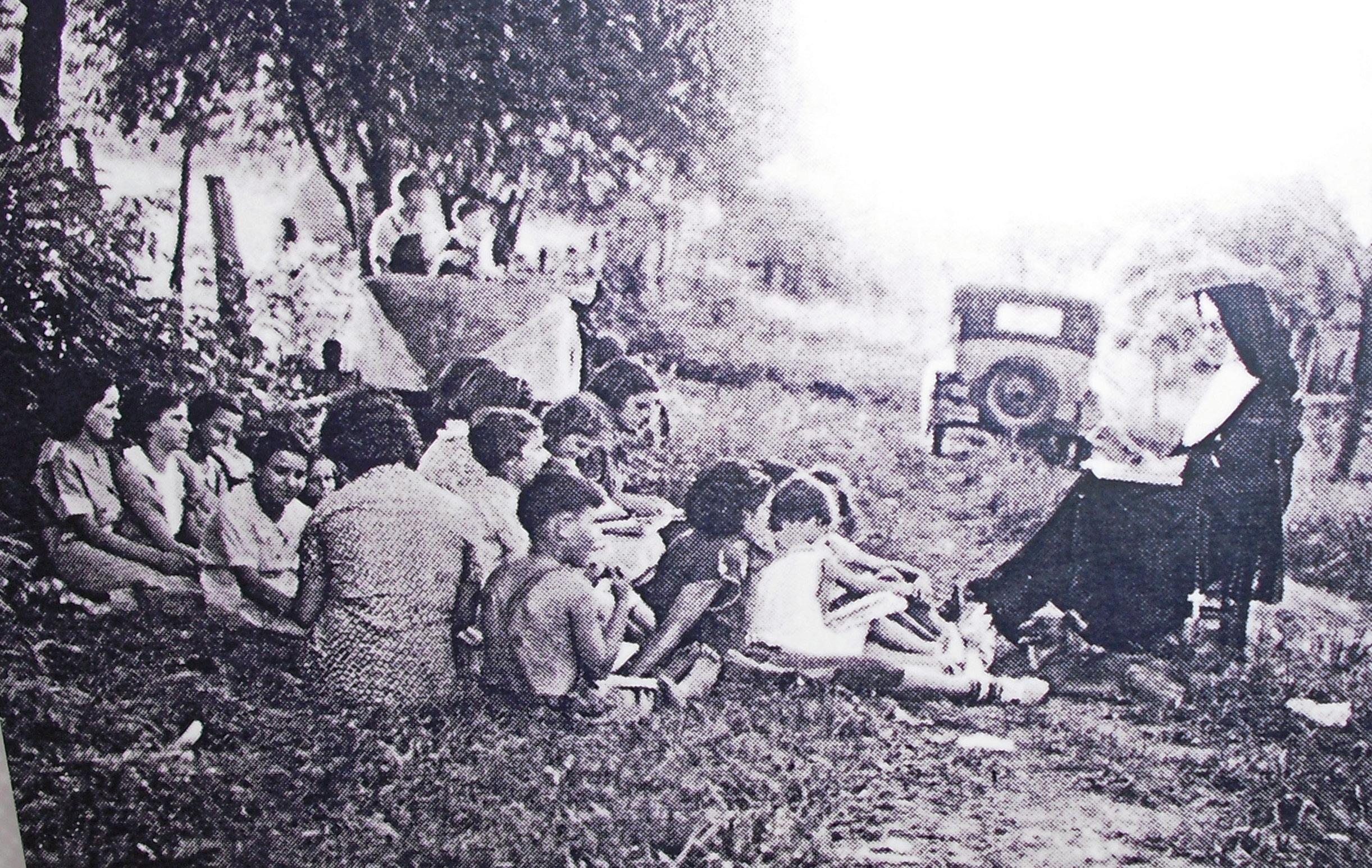Nun teaching young children in 1930